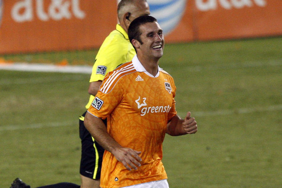 He's smiling because he's back to MLS competition