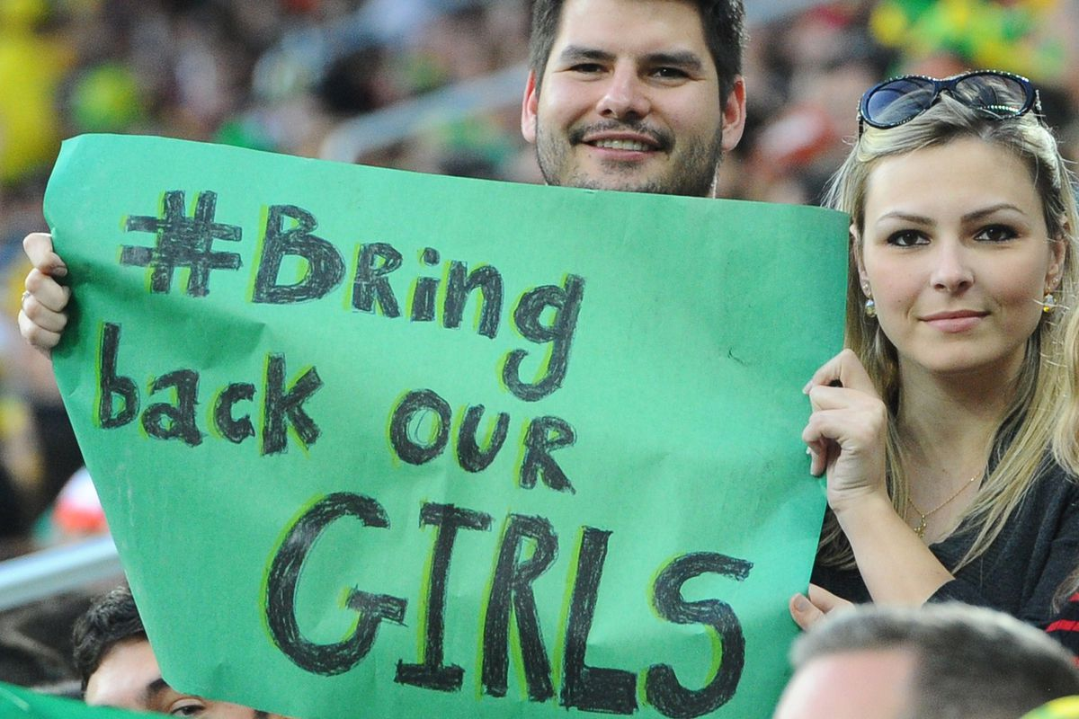 Soccer fans wave a #BringBackOurGirls sign at a World Cup match in Brazil