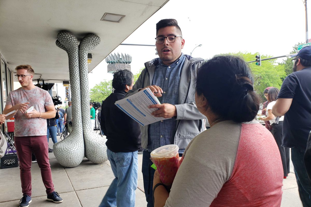 Ald. Carlos Ramirez-Rosa (35th) speaks to a woman on Friday outside a CTA Brown Line station ahead of anticipated ICE raids in Chicago.