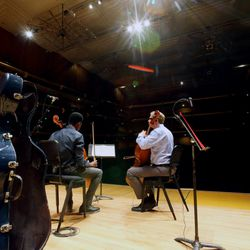 Getro Joseph, a young cellist from Haiti, plays with John Eckstein, right, of the Utah Symphony as the two have a short practice session at Abravanel Hall in Salt Lake City on Saturday, Dec. 7, 2019. Getro also met with Congressman Ben McAdams, who assisted Getro with the visa process for his trip to Utah.