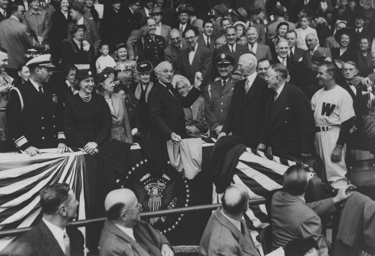 President Harry S. Truman throws the first baseball pitch at Griffith Stadium in Washington, DC on April 18, 1950.