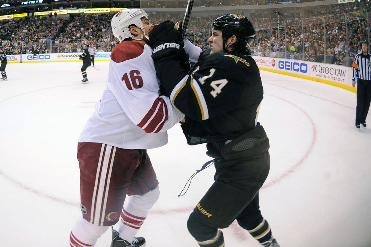 Phoenix Coyotes defenseman Rostislav Klesla (16) and Dallas Stars left wing Jamie Benn (14) fight for position during the first period at the American Airlines Center. Mandatory Credit: Jerome Miron-US PRESSWIRE