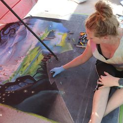 Camille Grimshaw works onchalk art during the fourth year of Chalk the Walk in West Jordan on Saturday, Sept. 5, 2020. The County Library welcomed chalk artists and their fans to participate in the library's first in-person event since COVID-19 measures went into effect in March.