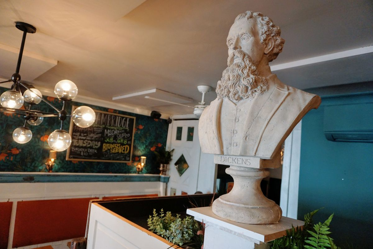 bust of charles dickens inside a restaurant