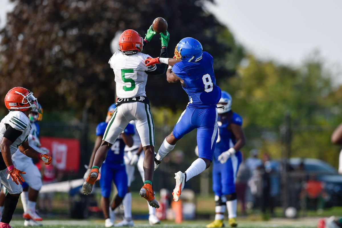 Morgan Park's Jonas Lee (5) intercepts a pass intended for Simeon's Malik Elzy (8) in the final minute of the game.
