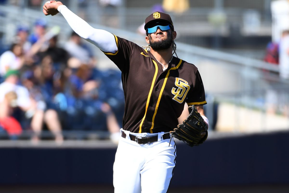 Fernando Tatis Jr of the San Diego Padres makes a throw to first base against the Los Angeles Dodgers during a spring training game at Peoria Stadium on March 09, 2020 in Peoria, Arizona.