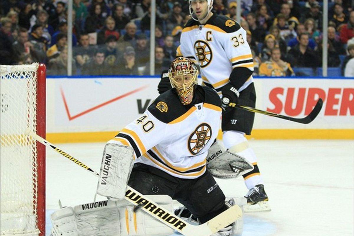 Feb 24, 2012; Buffalo, NY, USA; Boston Bruins goalie Tuukka Rask (40) makes a stick save against the Buffalo Sabres as defenseman Zdeno Chara (33) looks on.  Mandatory Credit: Kevin Hoffman-US PRESSWIRE
