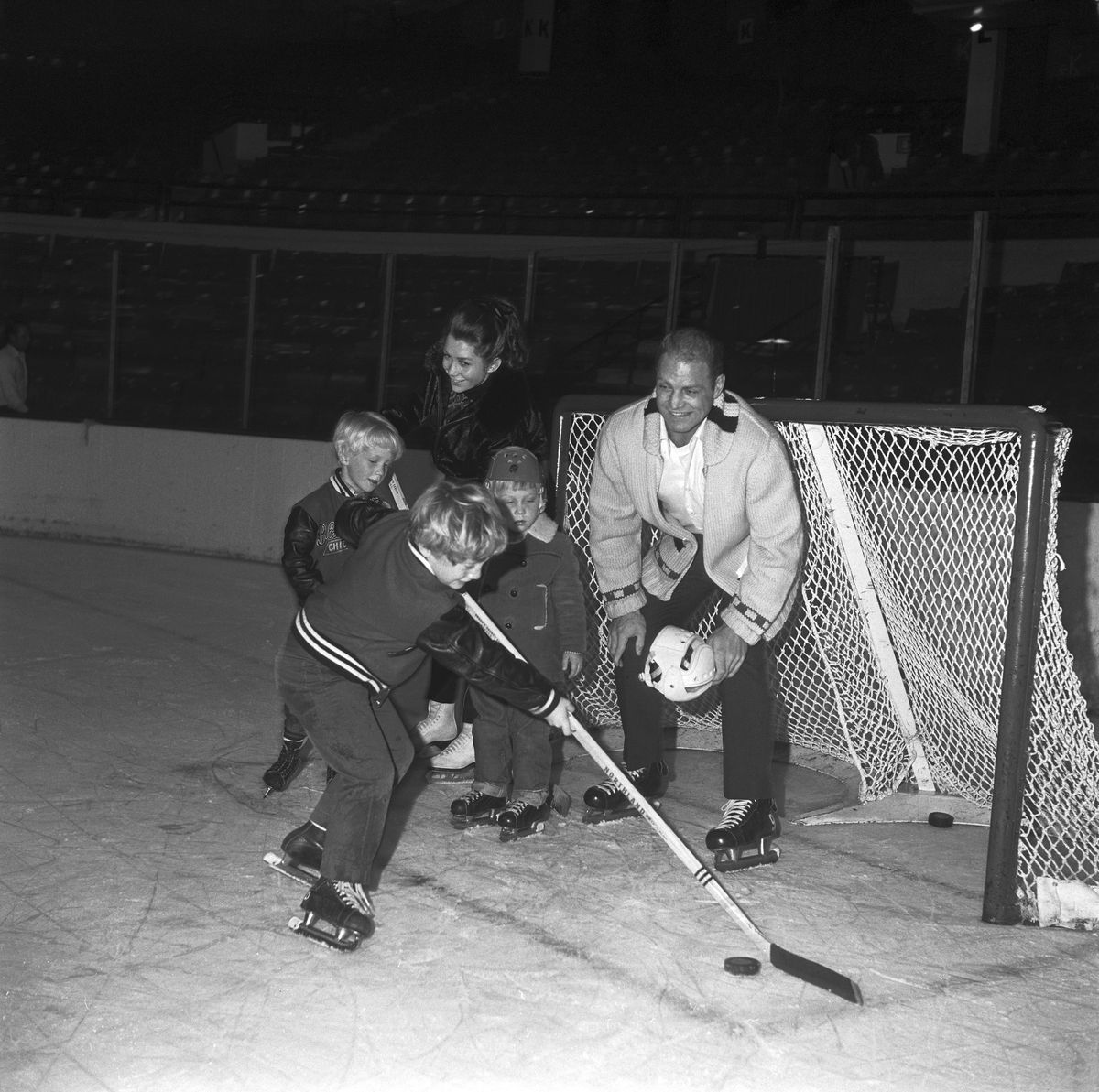 Bobby Hull on Ice with his Children