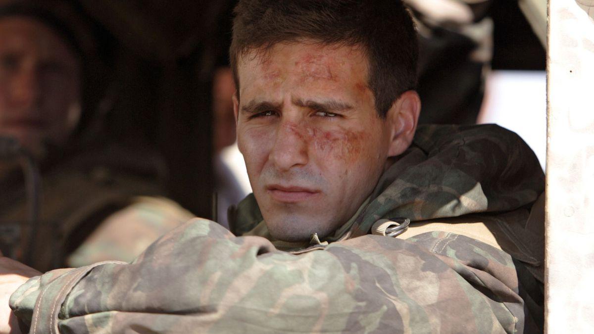Ransone, in military uniform, sits in a car.