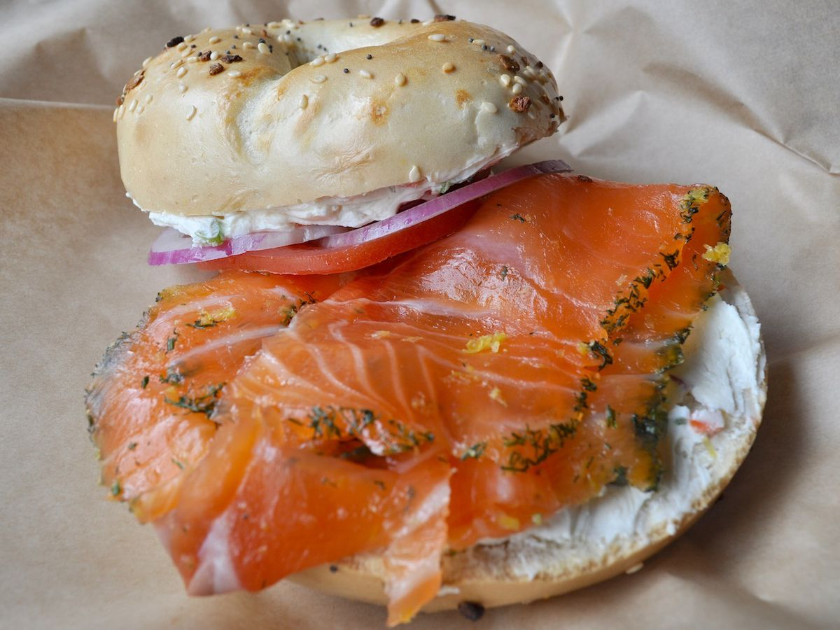 Bagel with gravlax, cream cheese, tomato, red onion, and capers