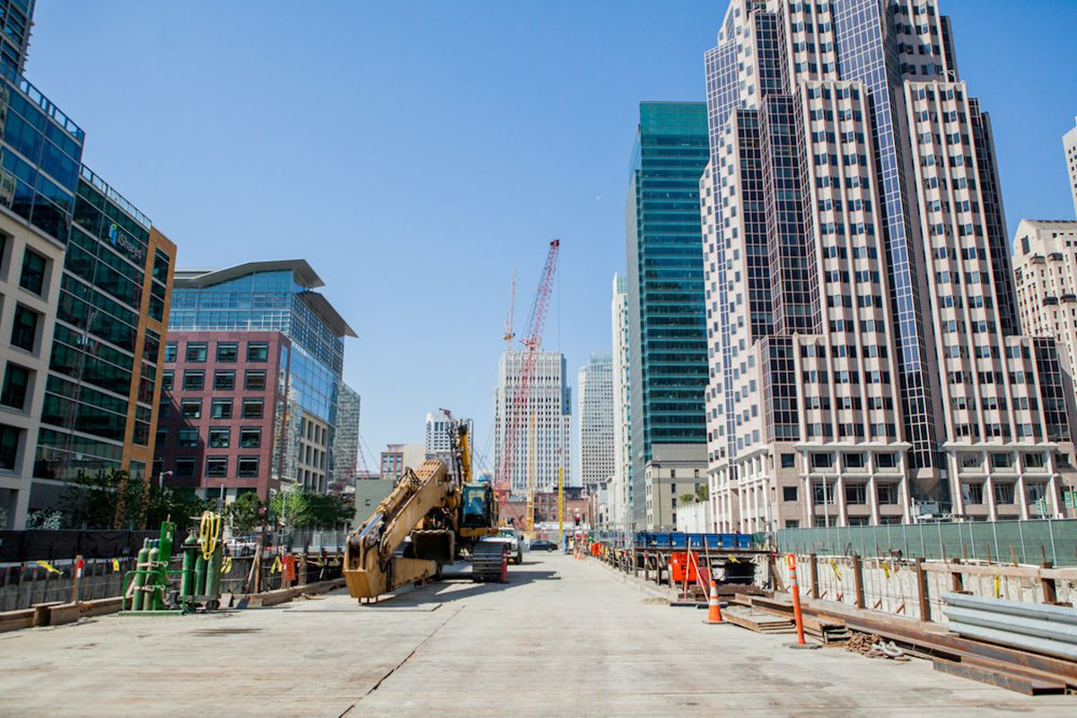 """Long-armed excavator on bridge above work site [Photo by <a href=""""http://www.patriciachangphotography.com/"""">Patricia Chang</a>]"""