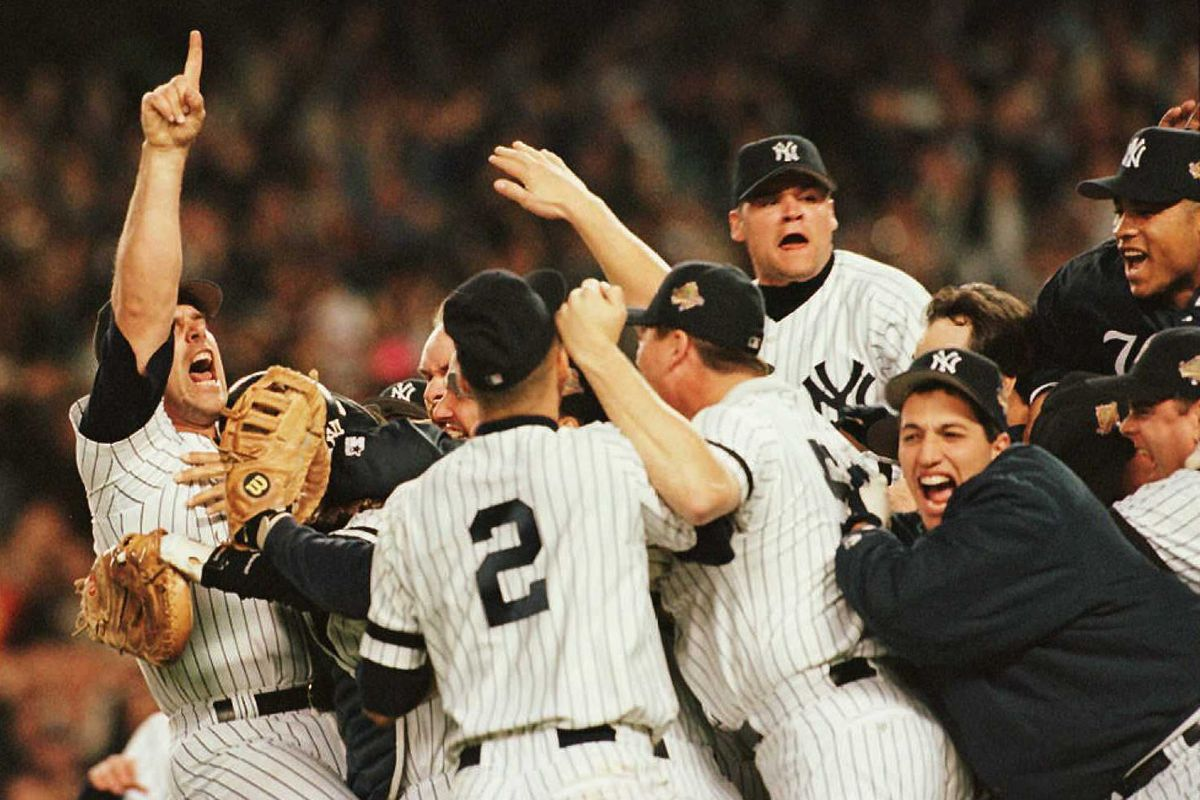 Members of the New York Yankees celebrate on the p