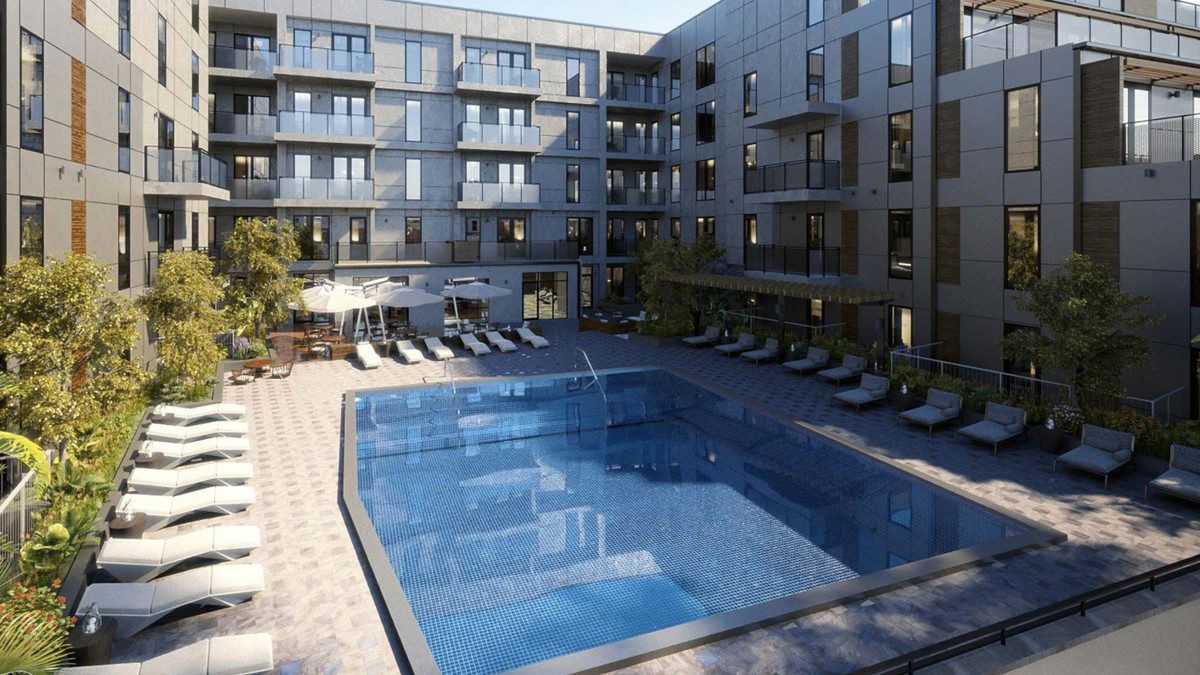 The building's pool courtyard includes an outdoor summer kitchen.