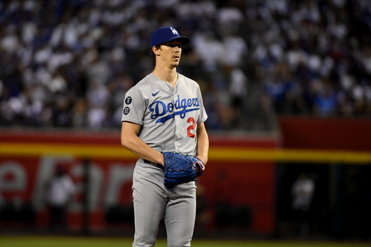 Walker Buehler #21 of the Los Angeles Dodgers delivers a pitch against the Arizona Diamondbacks at Chase Field on June 19, 2021 in Phoenix, Arizona.