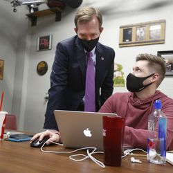 Rep. Ben McAdams, D-Utah, and his campaign manager, Andrew Roberts, look at election results at Pat's Barbecue in Salt Lake City on election night, Tuesday, Nov. 3, 2020. McAdams is trying to win a second term and is being challenged by Republican Burgess Owens.