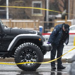 Chicago police investigate the scene where an off-duty Chicago police officer was shot in the 8900 block of South Stony Island Ave. in Calumet Heights, Monday, March 15, 2021.