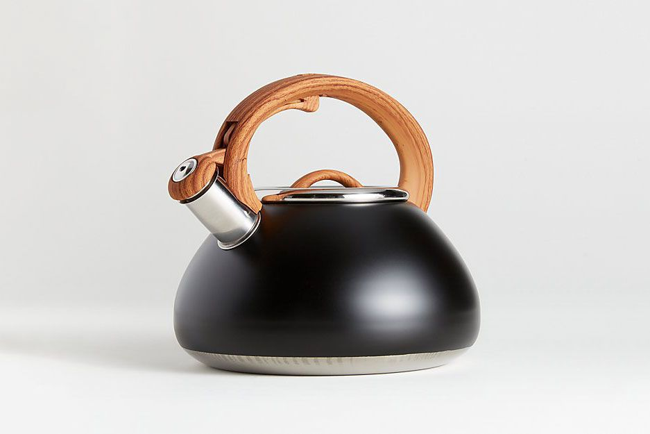 A matte black tea kettle with wood-look handle