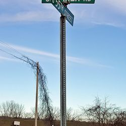 When the missionaries to the Native Americans arrived in Independence, Mo., Oliver Cowdery, Parley P. Pratt and Frederick G. Williams crossed the western boundary of Missouri into Indian lands to preach the gospel. The street sign, right, identifies one place where they preached. According to Max H. Parkin, it is the site of the Shawnee Indian camp near the Kansas River. in the present-day Kansas City, Kan., area. Ziba Peterson and Peter Whitmer Jr. stayed in Independence to earn needed money. Whitmer found employment as a tailor boarding in a home situated where the brick building, above, now stands. The owner was Lilburn W. Boggs. When Boggs was later elected lieutenant governor of the state, Peter Whitmer Jr. made him a new suit of clothes. Boggs would issue the ?Extermination Order? in 1838, driving the Latter-day Saints from Missouri.