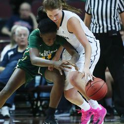 Brigham Young Cougars forward Amanda Wayment (4) and San Francisco Lady Dons forward Hashima Carothers (44) compete for the ball during the WCC tournament championship in Las Vegas Tuesday, March 8, 2016. San Francisco won 70-68.