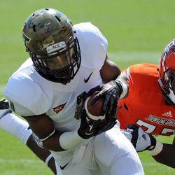 Virginia Tech tailback J.C. Coleman (4) scores a touchdown against Bowling Green defensive back Josh Pettus (22) during the first half of an NCAA college football game Saturday, Sept. 22,  2012, at Lane Stadium, in Blacksburg, Va.
