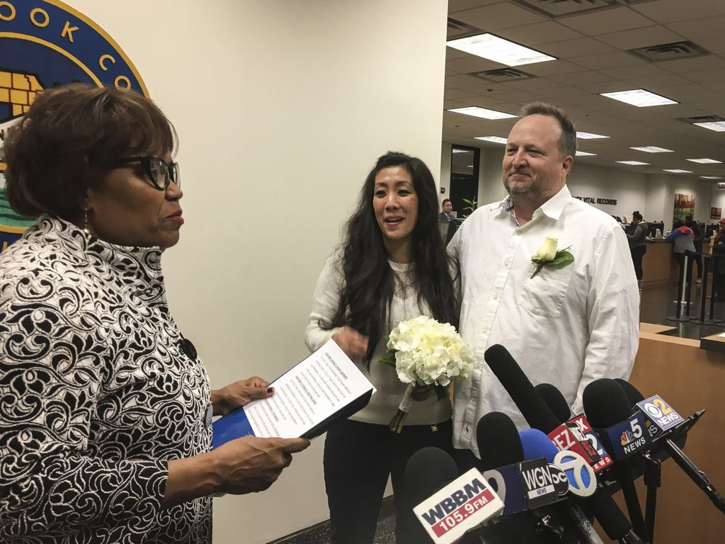 County Clerk Karen A. Yarbrough, left, officiates at the wedding of the first couple — David Lakoskey, 54, and Kristina Skare, 42, — to married in Cook County in 2019.