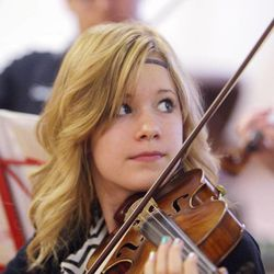 Gifted Music School orchestra student Aubree Oliverson practices in Salt Lake City on April 13.
