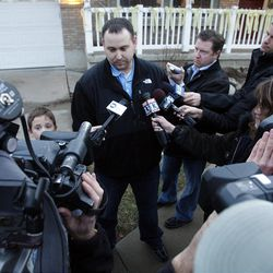 Evan Lewis talks with the media after he brought his wife home from the hospital in Centerville  Thursday, Dec. 29, 2011. Clara Lewis was severely injured in mid-November when her vehicle was struck by a FrontRunner train in Kaysville at a crossing.