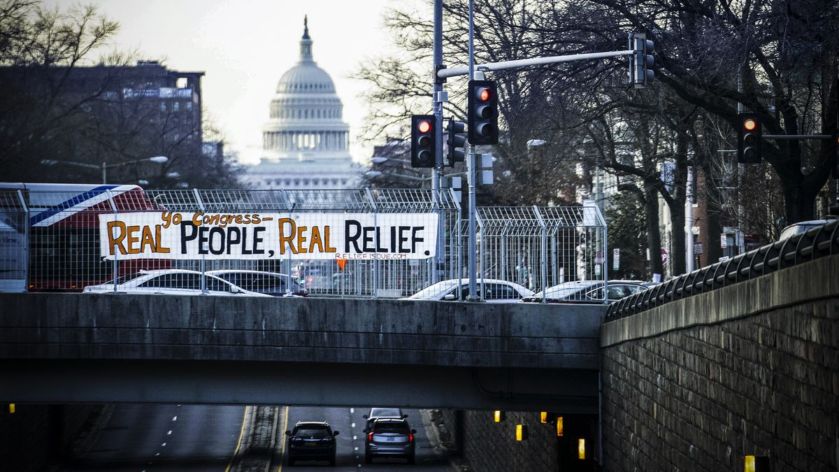 """A banner reading """"Yo Congress - Real People, Real Relief"""" is displayed over North Capitol Street near the US Capitol in Washington, DC, on February 26."""