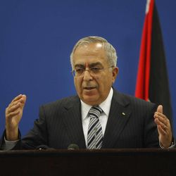 Palestinian Prime Minister Salam Fayyad holds a press conference in the West Bank city of Ramallah, Tuesday, Sept. 11, 2012. As part of his efforts to calm the growing unrest in the West Bank over the high cost of living, Fayyad on Tuesday said the Palestinian Authority will decrease fuel prices and cut salaries of top officials.