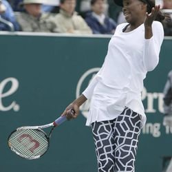 Venus Williams reacts to a bad shot against Samantha Stosur, of Australia, during their quarterfinals match at the Family Circle Cup tennis tournament in Charleston, S.C., Friday, April 6, 2012.