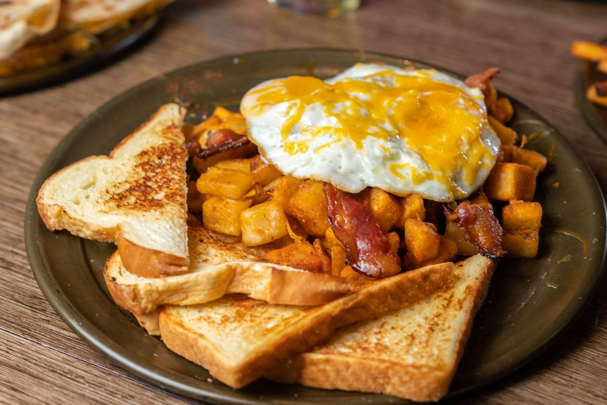 two eggs any style with choice of applewood smoked bacon, sausage, pulled pork, or pulled chicken and home fries