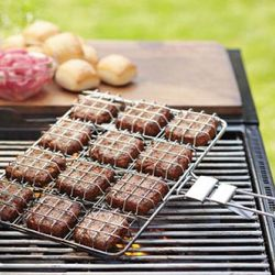 """Slider Grilling Basket ($29.95), <a href=""""http://www.williams-sonoma.com/products/slider-burger-grilling-basket/?pkey=cgrill-tools"""" rel=""""nofollow"""">Williams Sonoma</a>"""
