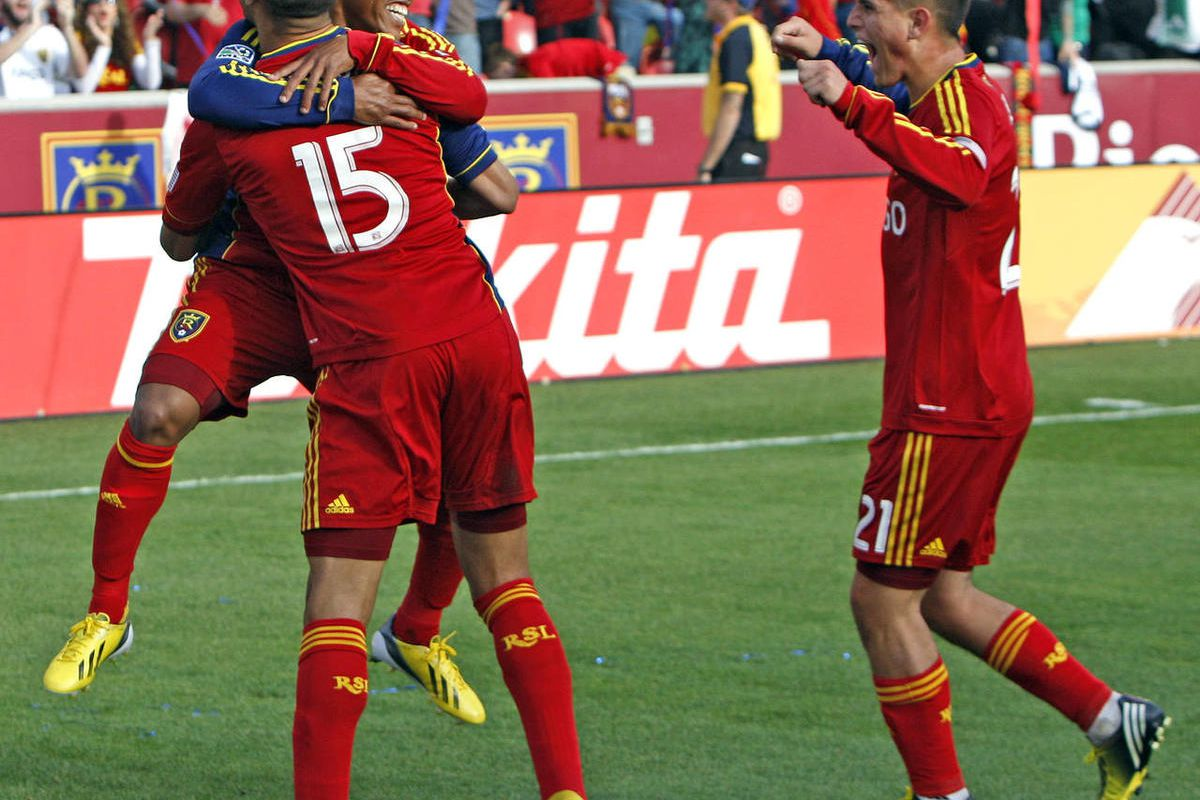 Real's Alvaro Saborio (15)  is hugged by teammates Luis Gil, left, and Joao Plata, right, after scoring as Real Salt Lake and the Colorado Rapids play to a 1-1 tie in the opening game of the MLS soccer season  Saturday, March 16, 2013, in Sandy.