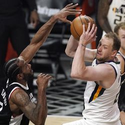 Utah Jazz guard Joe Ingles, right, tries to pass the ball while under pressure from Los Angeles Clippers forward Kawhi Leonard during the second half of Game 3 of a second-round NBA basketball playoff series Saturday, June 12, 2021, in Los Angeles.