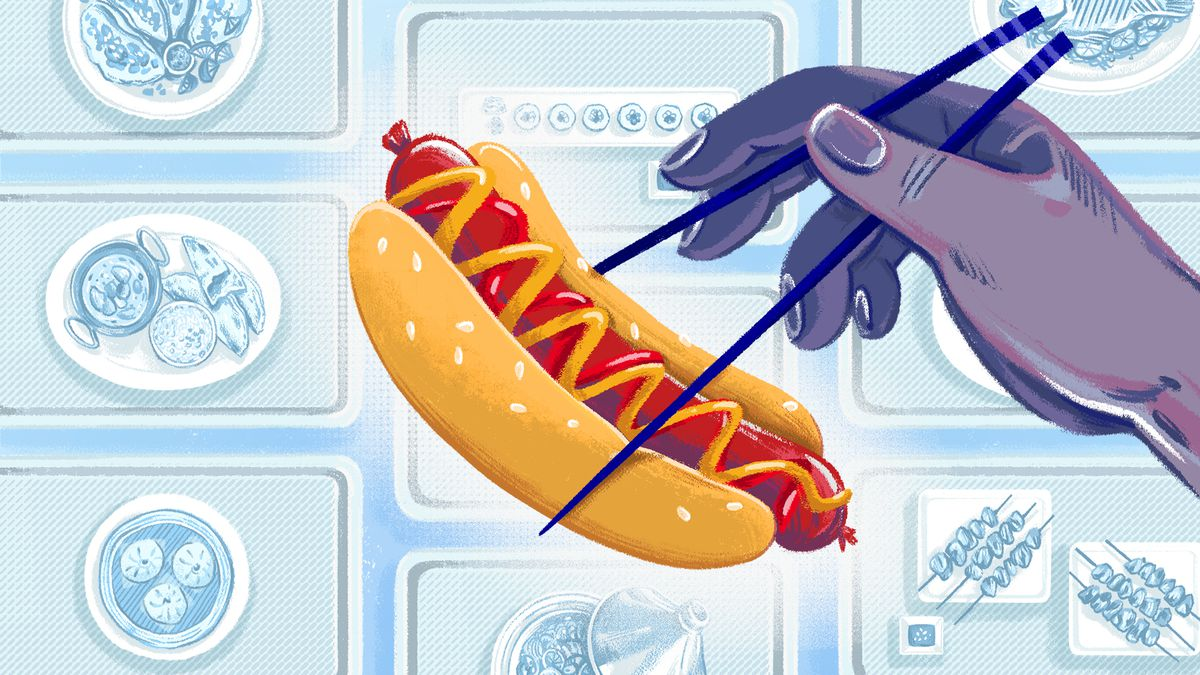 Illustration of a hand holding up a hot dog with chopsticks; in the background are cafeteria trays with different kinds of foods on them.