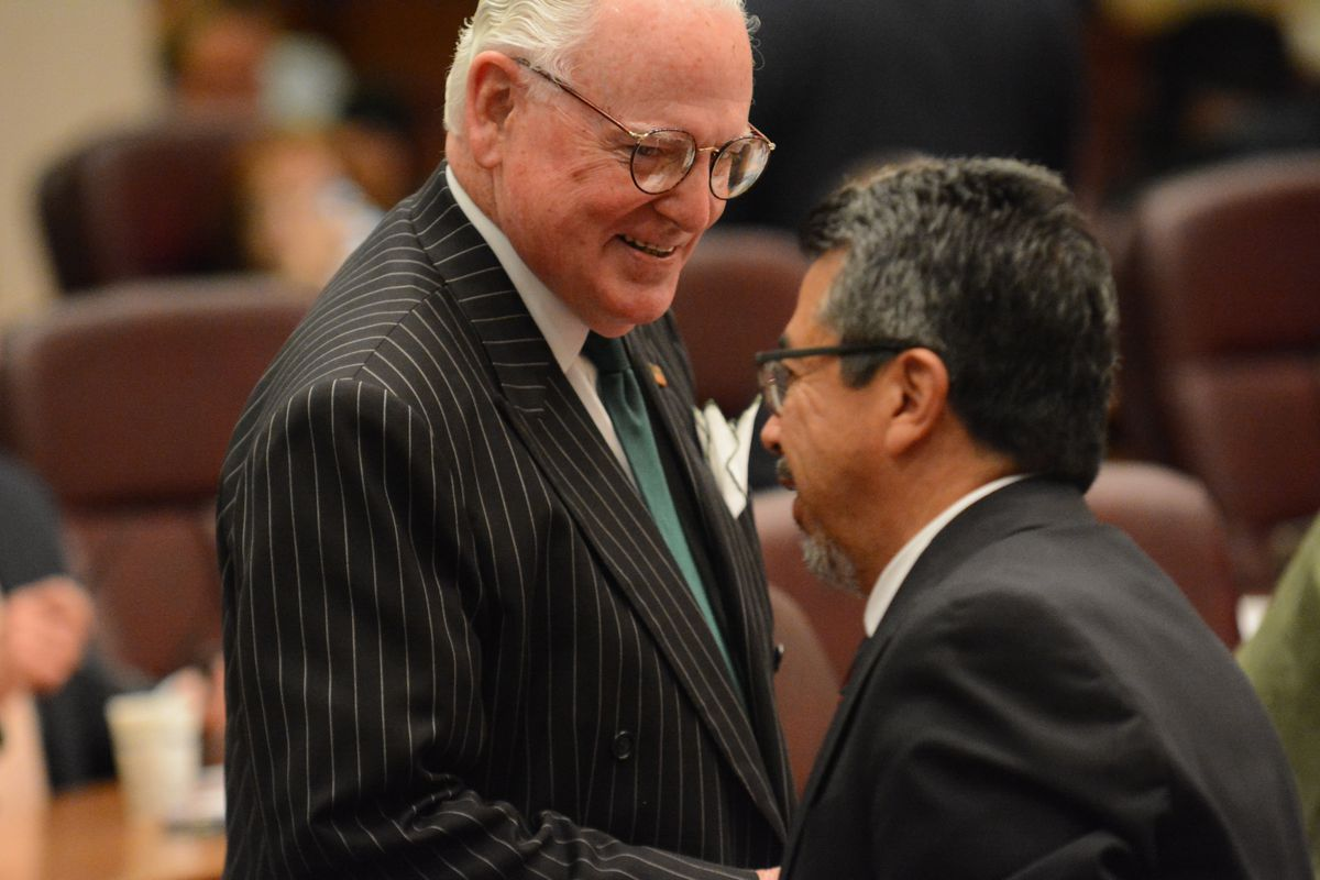 Former Ald. Danny Solis (right), seen joking with Ald. Edward Burke (14th) at a 2016 Chicago City Council meeting, has tapped campaign funds to pay $220,000 over the past year or so in legal fees.