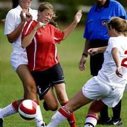 Bountiful's Emily Davis, center, tries to clear the ball from Park City's Lexi Malone, left, and Kristen Albrecht as Park City hosts Bountiful in preseason high school soccer on Tuesday. Bountiful won 6-0.