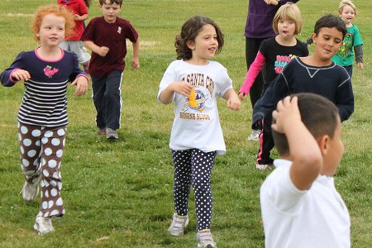 Kindergarten students participate in the fun run at Lowry Elementary School in Denver last year.