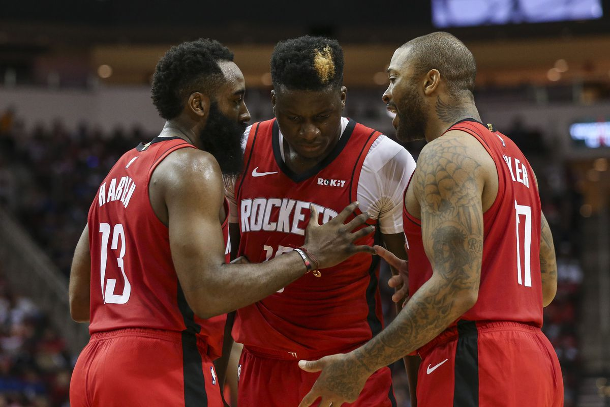 Houston Rockets guard James Harden and center Clint Capela and forward PJ Tucker talk after a play during the second quarter against the Dallas Mavericks at Toyota Center.