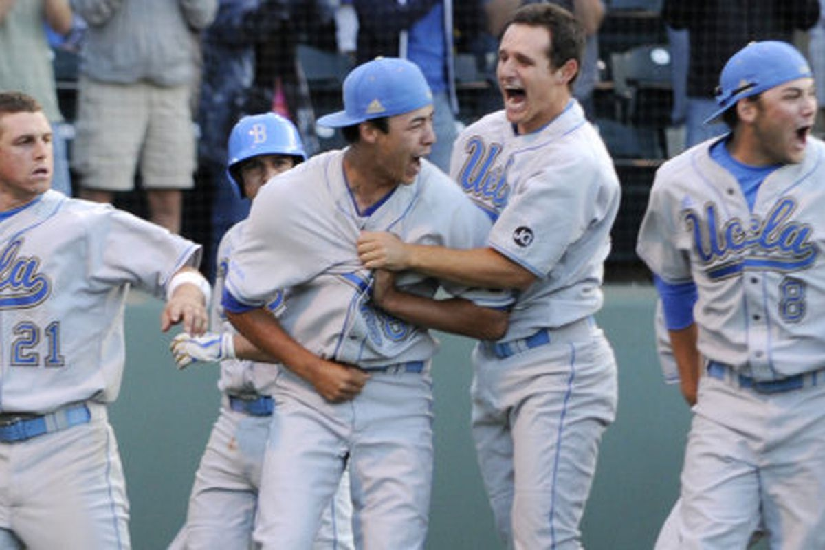 <em>Somewhere upstairs Coach and Nell were grinning over this. Photo credit:  Carlos Delgado/UCLA Athletics </em>