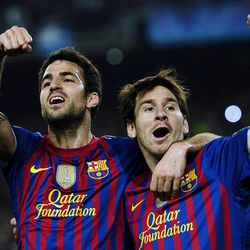 FC Barcelona's Lionel Messi, from Argentina, right, reacts after scoring against AC Milan with his teammate Cesc Fabregas during the 2nd leg, quarterfinal Champions League soccer match at the Camp Nou, in Barcelona, Spain, Tuesday, April 3, 2012.