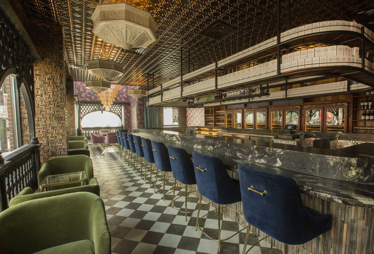 The granite bar with fish boxes above it.
