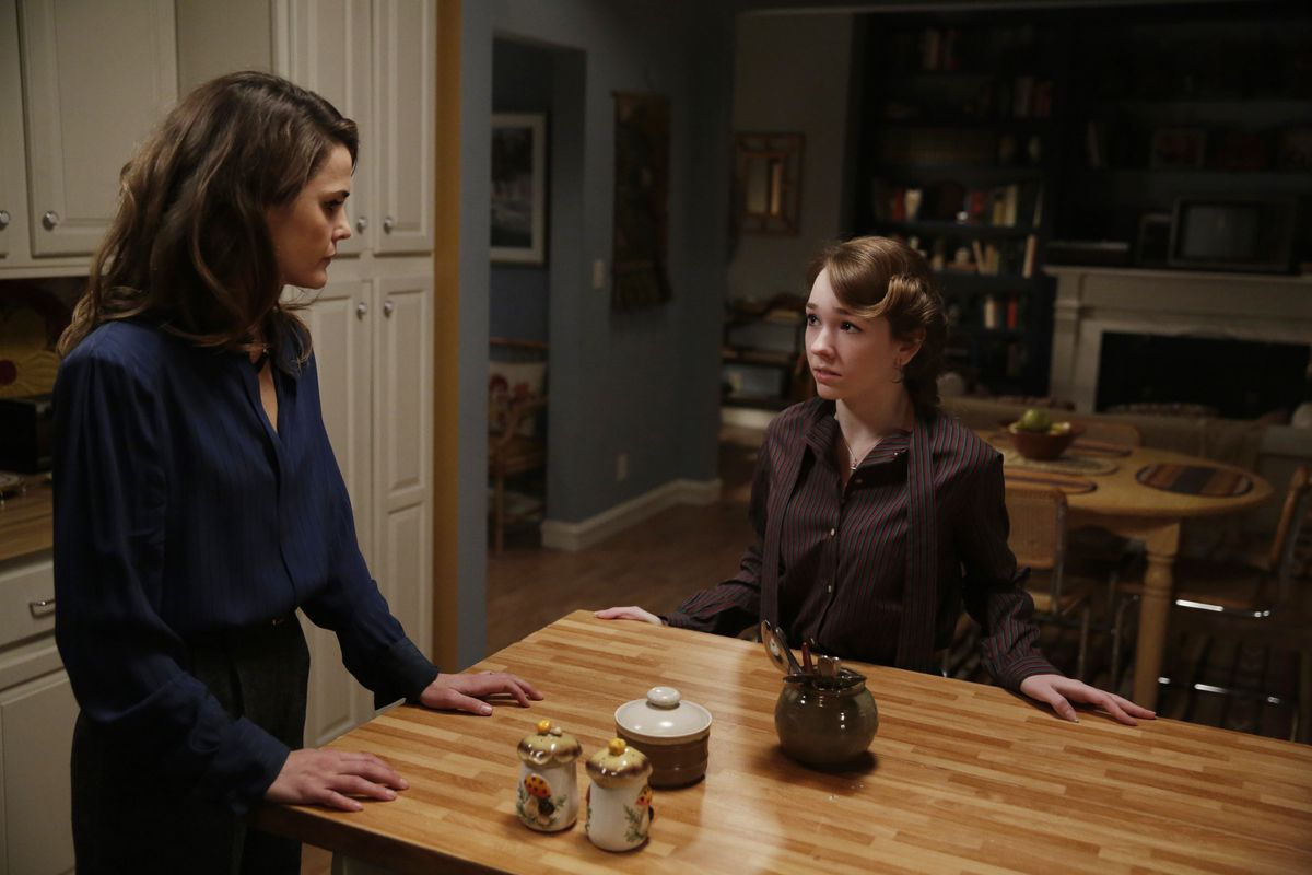 Elizabeth (Keri Russell, standing) has a conversation with her daughter, Paige (Holly Taylor), that she's needed to have for a long time.
