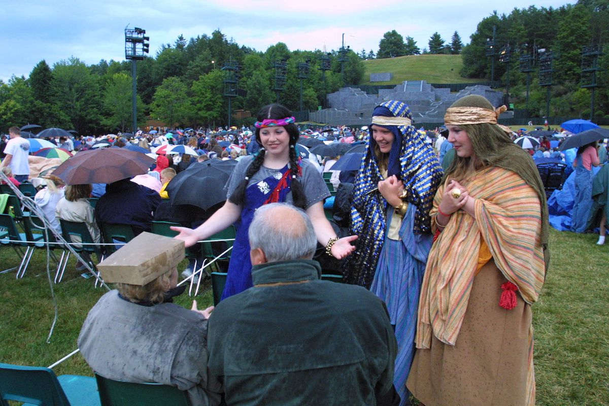 Hill Cumorah Pageant cast members talk to members of the audience before the show on July 7, 2001. The Church of Jesus Christ of Latter-day Saints has canceled the 2021 performance and it will not be held in the future.