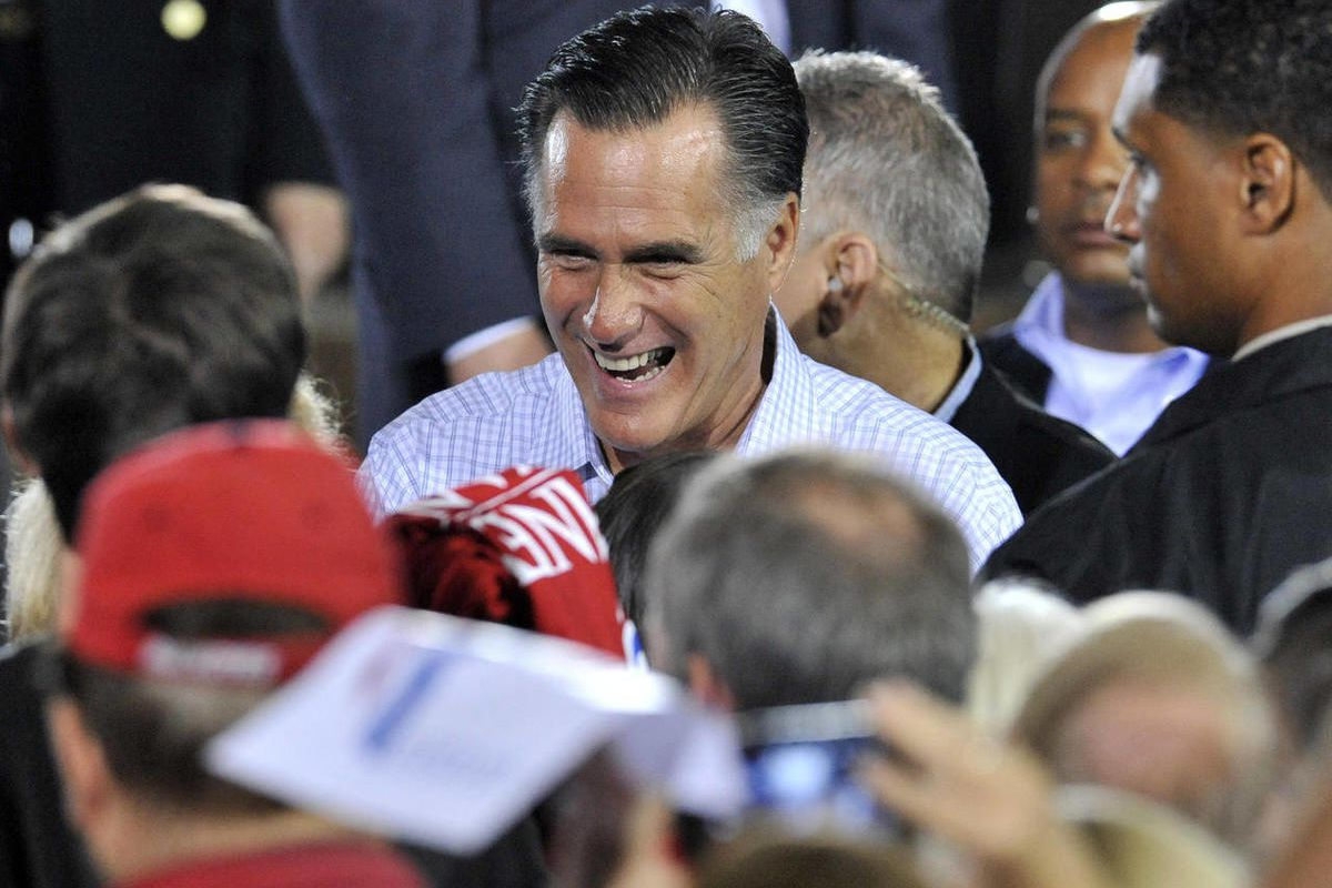 Republican presidential candidate, former Massachusetts Gov. Mitt Romney talks with supporters during a campaign stop at American Spring Wire, Wednesday, Sept. 26, 2012, in Bedford Heights, Ohio.