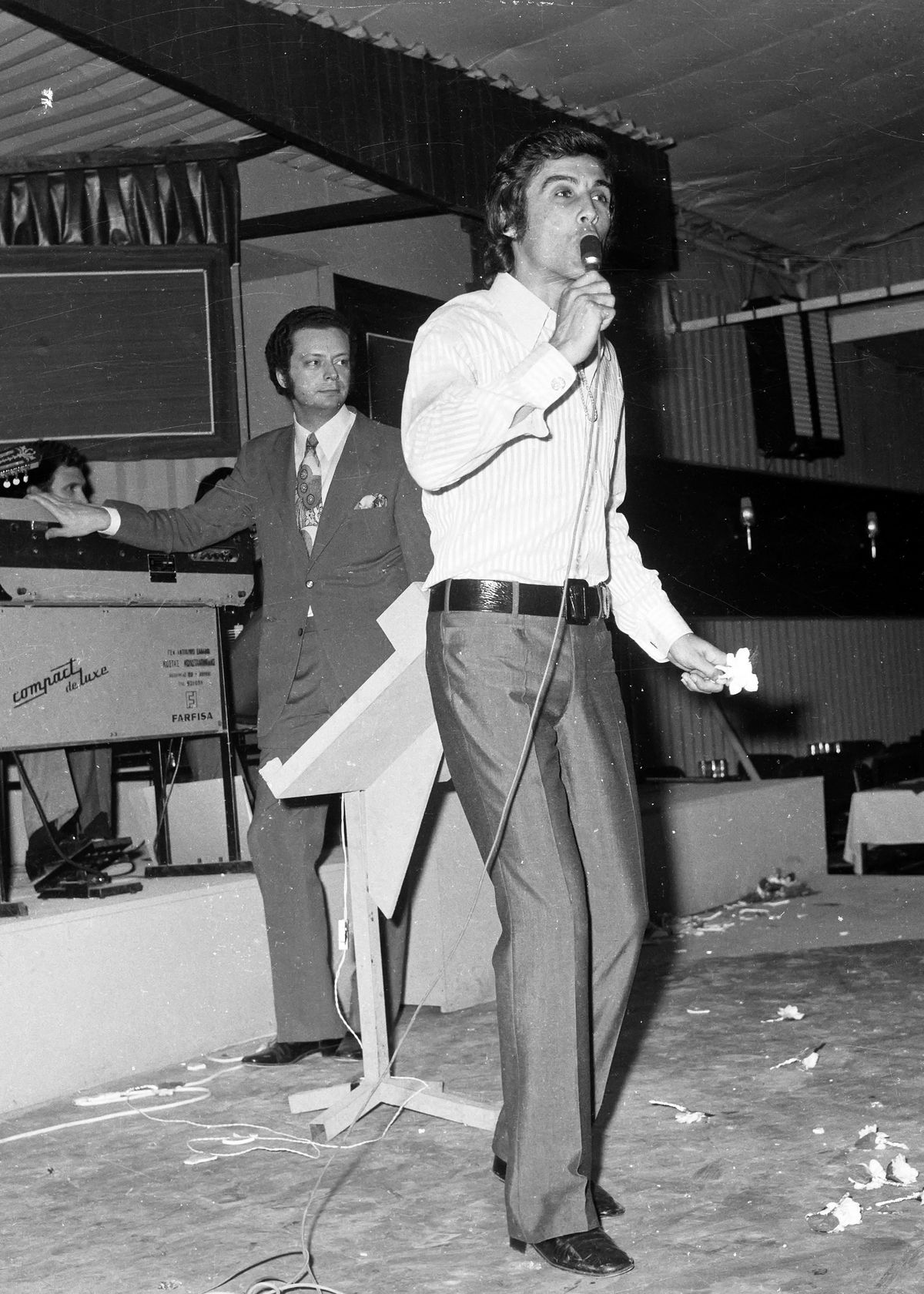 In this June 13, 1971, file photo, Greek popular folk singer Tolis Voskopoulos performs at a music hall in Athens, Greece.