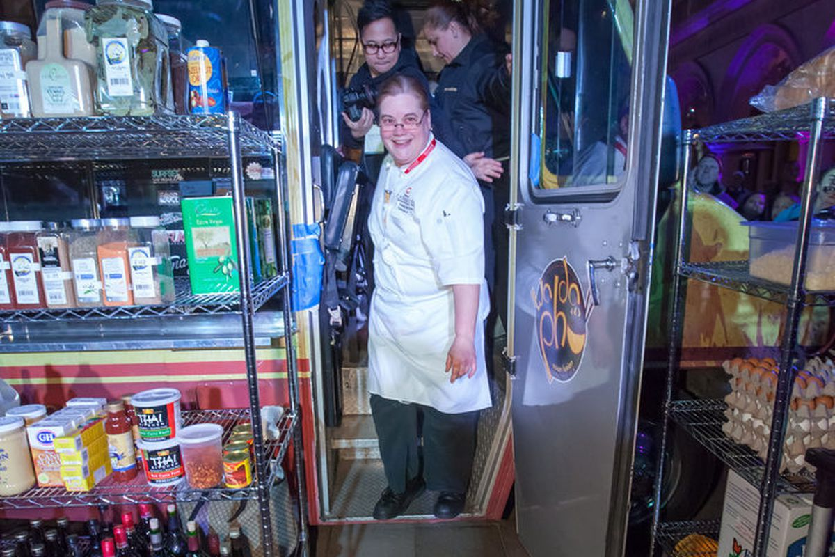 Donna Willey of Taqueria Canonita works on one of the food trucks.
