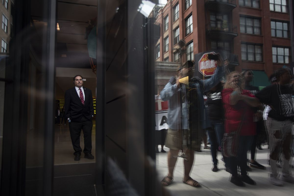 A man watches from inside McDonald's headquarters. | Colin Boyle/Sun-Times