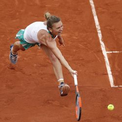 Romania's Simona Halep plays a shot in her semifinal match against Karolina Pliskova of the Czech Republic at the French Open tennis tournament at the Roland Garros stadium, in Paris, France. Thursday, June 8, 2017.