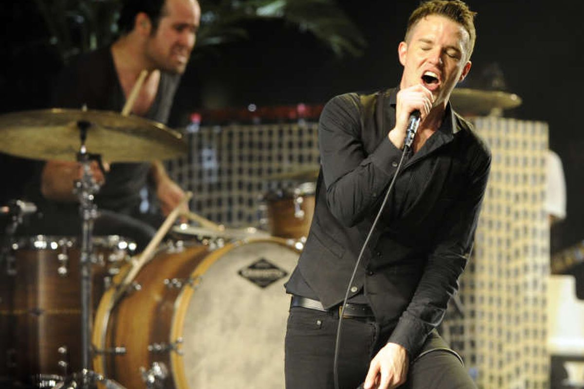 """Brandon Flowers and drummer Ronnie Vannucci Jr. of The Killers perform in 2009. The two rockers discussed their LDS faith on """"The Colbert Show."""""""